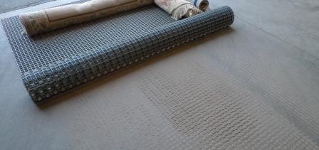 dusting a rug